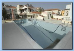 Cleaning th pool at Blue Sky
